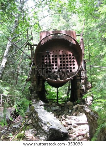 Rusted remnants from a mining operation deep in the Willamette National Forest. - stock photo