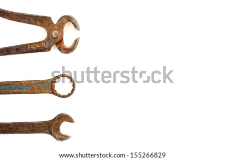 Rusted tools on a white background.