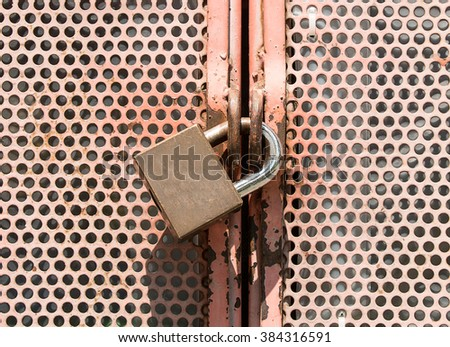 Rusted wire steel and lock key texture or background - stock photo