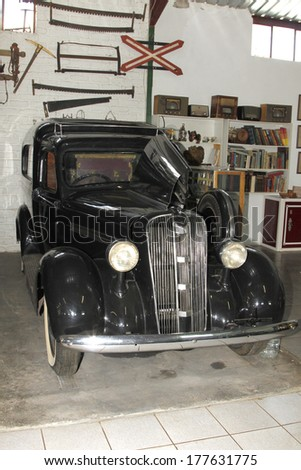 RUSTENBURG, SOUTH AFRICA - FEBRUARY 15:  Black 1937 Chevrolet Hearse  Front View in Private Collection Philip Classic Cars on February 15, 2014 in Rustenburg South Africa.    - stock photo