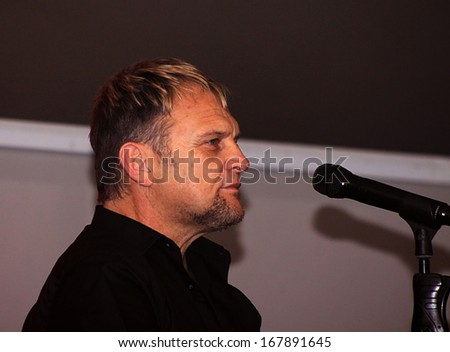RUSTENBURG, SOUTH AFRICA - JULY 26: Singer, Songwriter and Actor, Steve Hofmeyr Performing a Song on Stage on July 26, 2013, Rustenburg, South Africa.