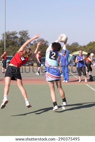 RUSTENBURG, SOUTH AFRICA - June 6:  Korfball League games played at Olympia Park on June 6, 2015 in Rustenburg South Africa.  Ladies team:  Girl catching ball.