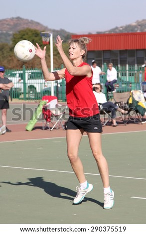 RUSTENBURG, SOUTH AFRICA - June 6:  Korfball League games played at Olympia Park on June 6, 2015 in Rustenburg South Africa.  Ladies team:  Girl goal trowing ball at net.