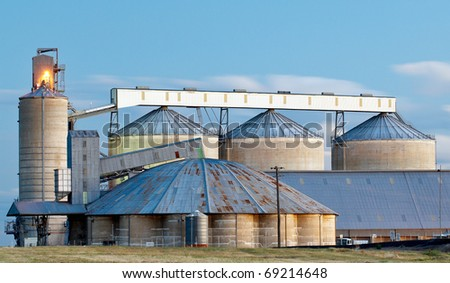 Rustic agricultural grain silos as shot at dusk on the Newell Highway in Outback New South Wales - stock photo