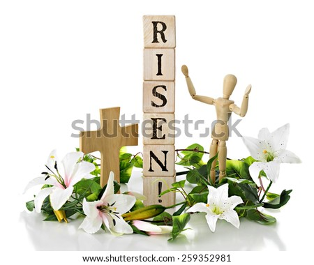 """Rustic alphabet blocks arranged to say, """"Rises!"""" with a cross nearby and praising mannequin nearby.  All are surrounded by white Easter lilies and green leaves.  On a white background. - stock photo"""