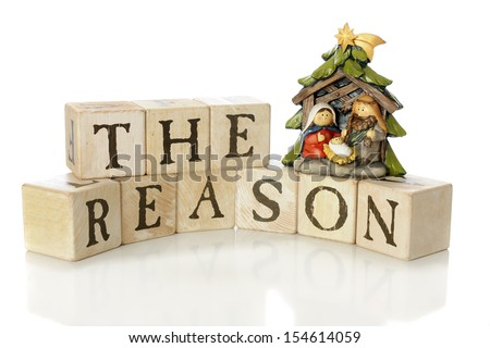 "Rustic alphabet blocks arranged to say, ""The Reason,"" with a small nativity scene (Mary, Joseph and Jesus only) to demonstrate that reason for the season.  On a white background.  - stock photo"