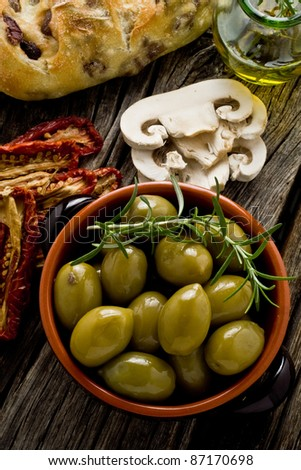 rustic appetizer with giants Spanish olives on a bowl - stock photo
