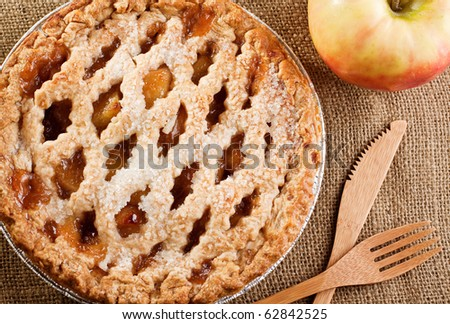 Rustic Apple Pie with bamboo knife and fork - stock photo