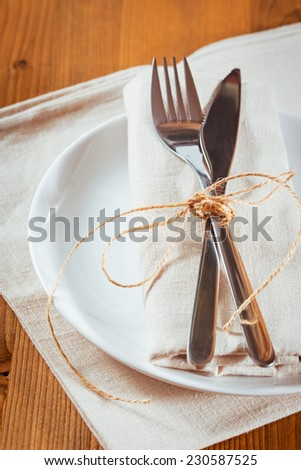 Rustic autumn table setting on wooden table - stock photo