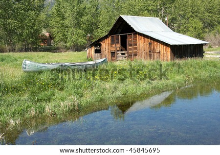 Rustic barn and canoe