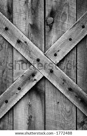 Rustic barn door - Period correct style and materials (Ponderosa Pine) for mid-1800's American Western Frontier (black and white). - stock photo