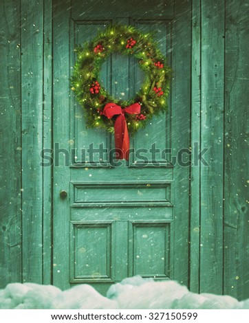 Rustic barn door with Christmas wreath