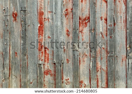 Rustic barn wood background with faded red paint. - stock photo