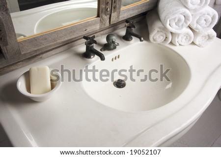 Rustic Bathroom Sink and Mirror - stock photo