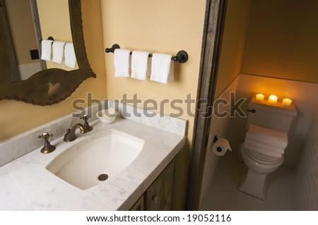 Rustic Bathroom Sink and Toilet Scene - stock photo