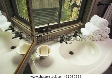 Rustic Bathroom Sink and Window - stock photo