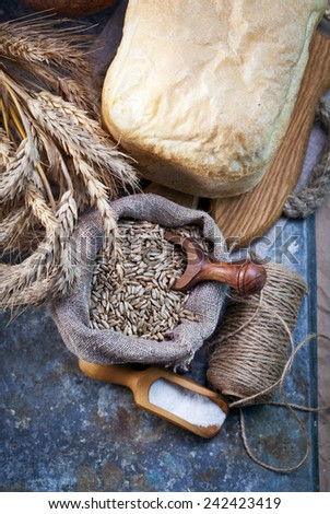 Rustic bread french, wheat  on old table. Old rural kitchen or bakery. - stock photo