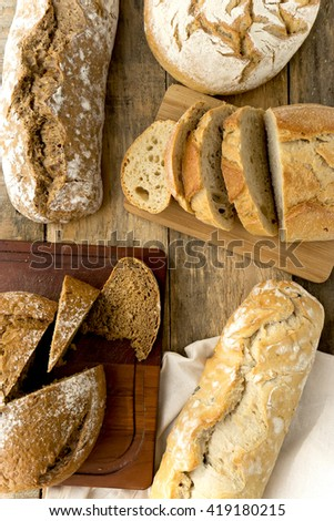 Rustic bread on   wooden background - stock photo
