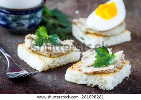 Rustic breakfast, boiled egg and toast with liver pate, tasty dish - stock photo