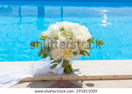rustic bridal bouquet of white peonies - stock photo