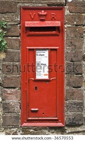 Rustic British post box - stock photo