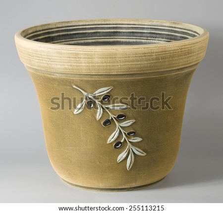 Rustic ceramic flower pot in beige with stylized decorative olives ornaments - stock photo