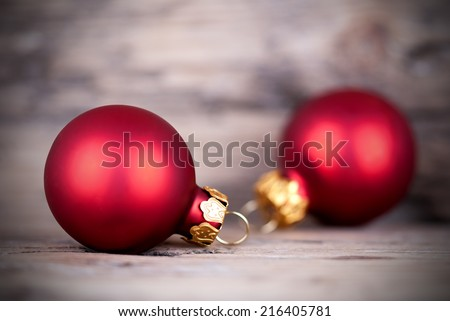 Rustic Christmas Background with Copy Space, two red Christmas Balls on Wood - stock photo