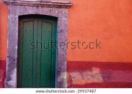 Rustic colorful door in the town of San Miguel de Allende, Mexico. Guanajuato. - stock photo