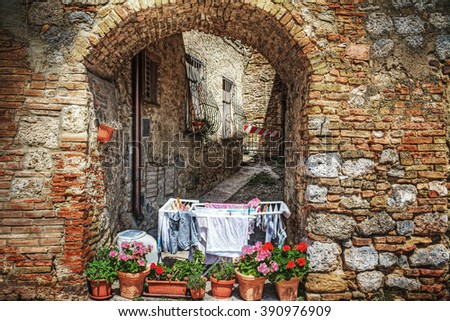 rustic corner in San Gimignano, Italy - stock photo