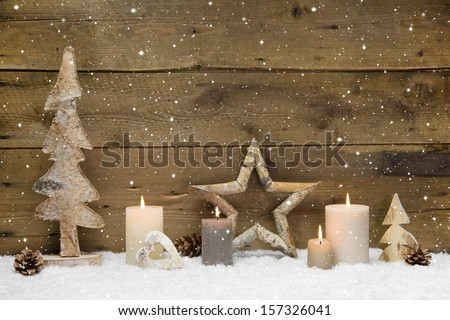 Rustic country background - wood - with candles and snowflakes for christmas - stock photo