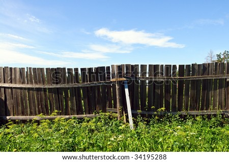 Rustic country fence and blue sky
