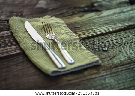 Rustic, country table setting on antique wooden table, shallow DOF