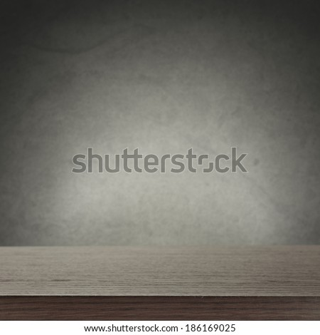 rustic desk and wall  - stock photo