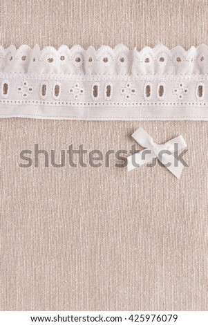 Rustic fabric for sewing, lace and accessories for needlework on old wooden background. Top view with copy space. - stock photo