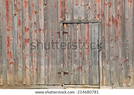 Rustic faded red barn wood background. - stock photo