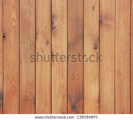 Rustic fence from wooden planks. Simple wooden background with a branches. - stock photo