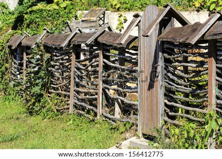 Rustic fence made of natural twigs with a wicket in Masuria in Poland - stock photo