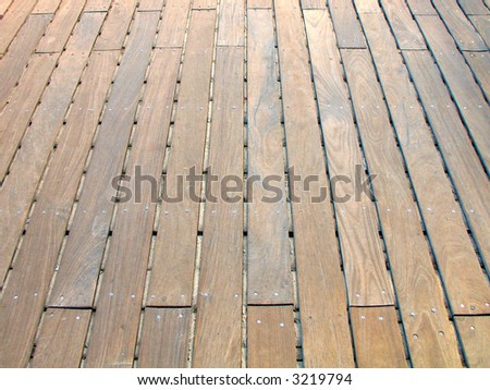 Rustic floor boards on boardwalk