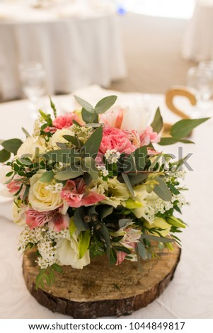 Rustic flower arrangement white pink flowers stock photo royalty rustic flower arrangement with white and pink flowers at a wedding banquet table set for mightylinksfo