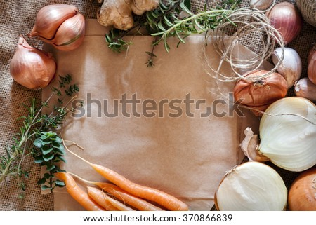 Rustic food background with brown paper and hessian.  Room for text. - stock photo