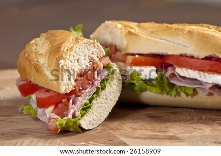 rustic french baguette with ham and cheese - stock photo