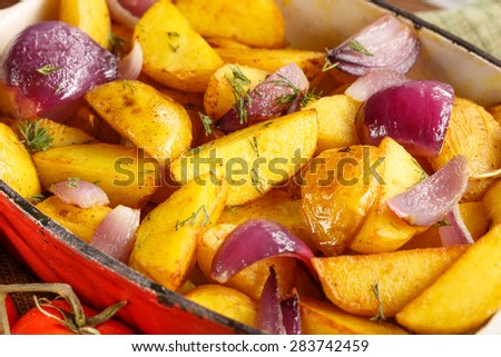Rustic Fried Potato with vegetables. Selective focus, dramatic shooting angle.