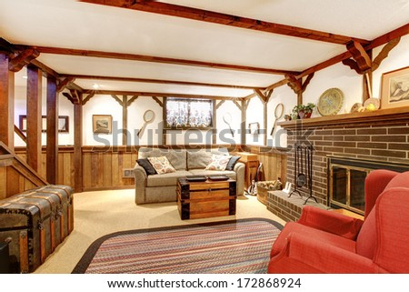 Rustic furnished family room with a stoned background fireplace old couch country style rug & Rustic Furnished Family Room Stoned Background Stock Photo (Royalty ...