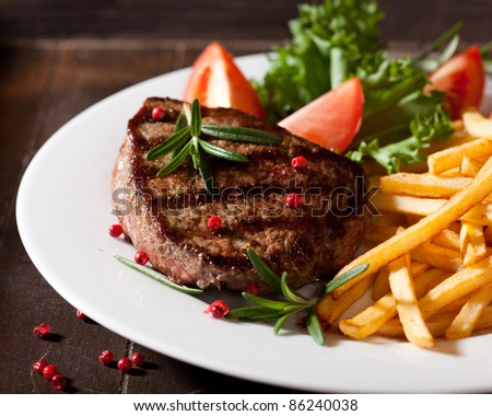 Rustic grilled beefsteak with french fries - stock photo