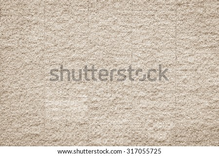 Rustic grunge granite tiled wall detailed pattern texture in natural light beige cream sepia color tone: Rough rock stone tile wall finishing material detail wallpaper backdrop for interior design     - stock photo