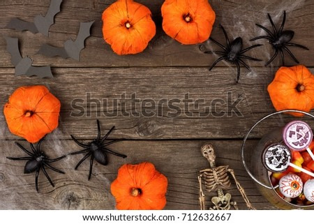 Rustic Halloween Frame Of Pumpkin Decor Spiderwebs And Candy Flat Lay Over A Wood