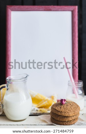 Rustic home made tasty oatmeal  cookies on the wooden background with milk. Selective focus photo with shallow DOF.   - stock photo