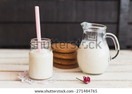 Rustic home made tasty oatmeal  cookies on the wooden background with milk. Selective focus photo with shallow DOF.