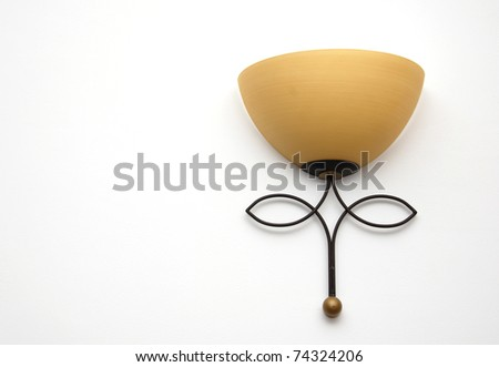 rustic lamp on white wall - stock photo