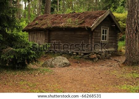 Rustic log house on the Seurasaari island near Helsinki in Finland - stock photo